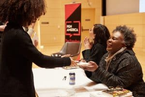 Claudia Rankine and Layli Long Soldier signing books at a PEN Out Loud event